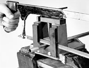 Cutting tube end with hacksaw