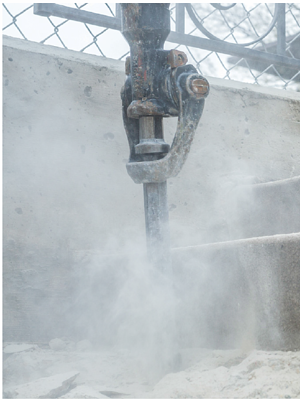 Using jackhammer to brake concrete creates dust and airborn RCS